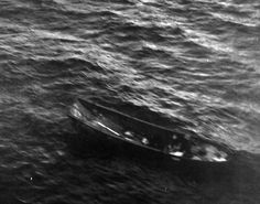 80-G-32120: Japanese landing boat adrift at North Alite Reef, Solmon Islands, probably 1942. Official U.S. Navy photograph, now in the collections of the National Archives.