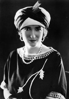A portrait of one Miss Ethel Levy wearing an eye-catching headdress, April 1923.