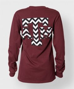 This longsleeve maroon shirt features a block ATM filled with a black and white chevron pattern on both the front and back