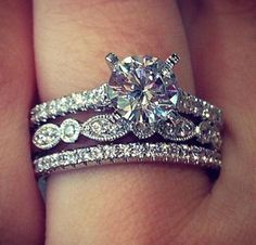 The exact ring that I want and beautiful wedding bands to go with! Love love love