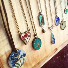 Necklaces made with pressed flowers ($28-72) are a great way to carry the great outdoors with you wherever you go. Gift one to the nature-lover who you love!