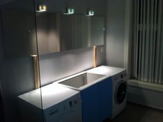 IKEA Hackers: All-In-One Multipurpose Bathroom Furniture which hides a washer & dryer---i could do this in my future master bath!!!