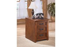 "The Cross Island File Cabinet from Ashley Furniture HomeStore (AFHS.com). The richly detailed mission design of the ""Cross Island"" home office collection captures the beauty of rich country style with a versatility that enhances any home environment."