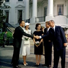 May 8, 1961 — Mercury astronaut Alan Shepard receives the NASA Distinguished Service Medal at the White House. Shepard and his family meet with President John F. Kennedy, first lady Jacqueline Kennedy, and Vice President Lyndon B. Johnson.(JFK Presidential Library and Museum)
