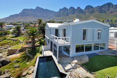 Accommodation in Cape Town: Luxury Villas & Apartments Private Property, Property For Sale, Property Search, Beach Cottages, Cape Town, The Rock, Shed, Deck, Outdoor Structures