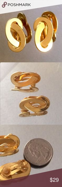 Matte Gold Clip Earrings Large matte gold twists.  Cushioned clip ons and are very comfortable! Jewelry Earrings