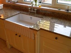 Baltic Brown Granite kitchen worktop with a polished sink cut-out and drainer grooves. Baltic Brown is mined in India. This natural stone comes in dark and medium shades. It is a fact that brown granite worktops have very neutral tones, allowing them to blend in with almost any type and style of kitchen, contemporary and traditional. Choose a light coloured brown granite worktop to compliment dark coloured furniture or a warmer brown to add warmth to a plain or pale coloured kitchen.