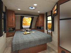 The Lance 1995 Travel Trailer comes with a spacious bedroom filled with a large bed and double night stands with lights! Travel Trailer Floor Plans, Large Beds, Panel Systems, Queen Beds, Solar Panels, Brother, Big, Teardrop Campers, Gallery