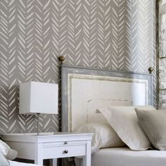 Brush Strokes Allover from Cutting Edge Stencils is a modern wall pattern that combines the Herringbone and Chevron designs with an artistic twist. Stenciled here on a bedroom accent wall in gray. http://www.cuttingedgestencils.com/brush-strokes-wall-pattern-stencil-modern-wall-stencils.html