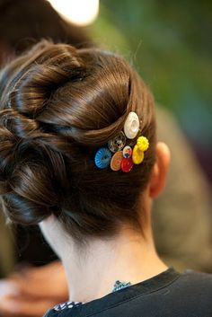 if i wear my hair up, clump a couple of button bobby pins together as a cute pop of color and fun