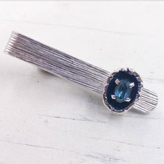 Check out this item in my Etsy shop https://www.etsy.com/listing/502664854/silver-tone-blue-rhinestone-tie-clip