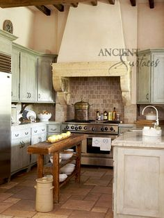 Add some warmth to your kitchen with one of our antique stone kitchen hoods that were at first especially deep antique fireplaces retrofitted to accommodate a fully functional kitchen hood vent inside of them.    Call: 212-461-0245 // 212-913-9588  Mail: Sales@AncientSurfaces.com  Web: www.ancientsurfaces.com/Kitchen-Stone-Ranges.html