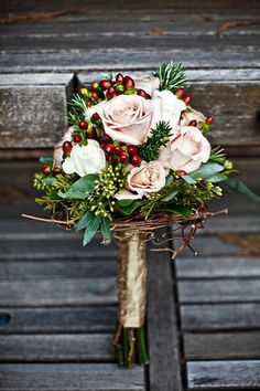 winter-rose-and-berry-bouquet.jpg (JPEG Image, 554 × 831 pixels) - Scaled (75%) I love this fall bouquet, the red berries and the little touch of rosemary it makes it so unique! By the way did you know that in medieval times instead of flowers the bouquet of a bride was made of ....herbs?