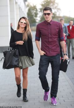 Robert Lewandowski showing off an interesting shoe choice while being out with his wife Anna. #Bundesliga