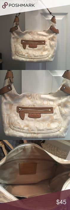 Beautiful cream coach bag. Medium to small in size Great bag in beautiful shape. Coach Bags
