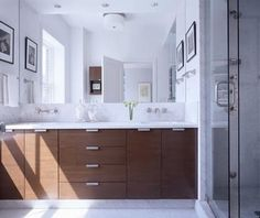 Master Bath: Our vanity will have a similar look and feel to this one, with wall mounted faucets and a clean line to the cabinetry. Do we do a slab to match the countertop for the wall behind the faucets? We will likely have two recessed mirrored cabinets over the vanity.