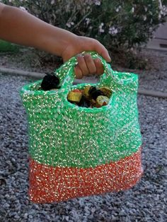 This is a FREE Pattern for you to Enjoy! I designed this Halloween Treat Bag to incorporate both a white color and reflective yarn so that the little ones in my life would be more visible while Tri…