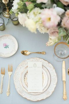 Gold flatware and pale blue linens are an elegant way to enhance your tablescapes.