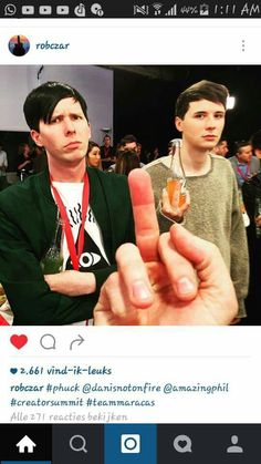 Phil looks like a dissapointed parent while Dan's just trying to give the finger back XD