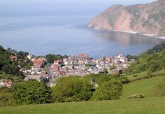 Lynton, Devon, with Lynmouth Bay beyond. Visit Devon, Homes England, Country Uk, Rocky Shore, English Village, Devon And Cornwall, North Devon, North Coast, Magic Carpet
