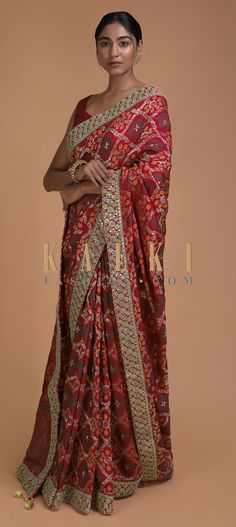 Crimson red saree in silk with weaved checks and floral motifs all over. Enhanced with zari, sequins and kundan work in floral pattern on the hemline. Saree Blouse Patterns, Saree Blouse Designs, Indian Dresses, Indian Outfits, Red Saree, Sari, Indian Designer Outfits, Traditional Sarees, Indian Couture