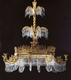 A German NeoClassical Gilt-Metal, Gilt-Wood & Cut Glass Chandelier, after a design by Karl Friedrich Schinkle, ca 1835. Approximate value: $50,000.