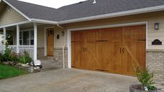 Cover the garage door with wood veneer? GarageSkins Give You a Wood Look Without the Cost