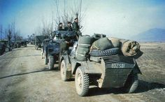 A Daimler Dingo scout car in the foreground and a Daimler armoured car behind somewhere in Korea