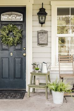 Spring Porch Tour - She Holds Dearly - - Redecorating your porch or front door every season is the perfect way to celebrate. Check out this spring porch tour with lots of farmhouse inspiration! Front Door Entrance, Front Door Colors, Front Door Decor, Front Door Plants, Front Porch Flowers, Porch Entry, Farmhouse Front Porches, Small Front Porches, Summer Front Porches
