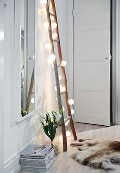 love the idea of adding the lights to the decorative ladder
