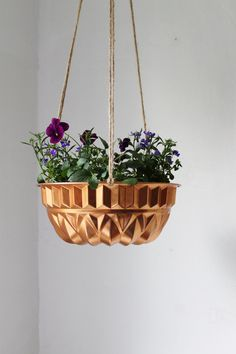 DIY Inspo: Bundt Cake Planter - UpCycled Copper Antique Baking Mold - Industrial Modern Reclaimed BootsNGus Hanging Flower Pot. $35.00, via Etsy.