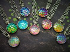 A gorgeous iridescent scales necklace, perfect for mermaid or dragon fans! Girly meets myth and magic these necklaces are eye catching and truly beautiful! 9 Colour Options Available!  ☆COUPON CODES☆ Use FREESHIP15 for Free Shipping to the UK when you spend £15! Use FREESHIP30 for Free Standard Shipping Internationally when you spend £30! ($46 USD, €41 EUR, $61 CAD, $65 AUD etc)  ☆ The Inspiration: When Im looking at buying new stock I never can resist a mermaid charm! When I saw these…