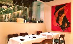 Bold artwork 'Rhapsodie en rouge' by contemporary French artist Jean Soyer in a fine dining restaurant in Chelsea.