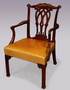 A mid 18th Century Chippendale period mahogany Armchair, having acanthus carved and scrolled top rail, above Gothic arch pierced back splat, and outswept carved, reeded arms. The Chair with stuff over leather seat supported on moulded legs with leaf carved brackets. Circa: 1760 Ref; 5707