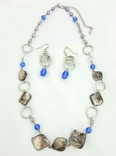 "Lia Sophia. ""Indigo"". Abalone Shell Beads. Necklace and Earrings. This set is in great used condition. One earring is missing the rubber back. 