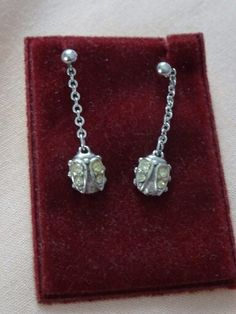 April 5th - tiny. Tiny jewelled bugs on a pair of earrings.
