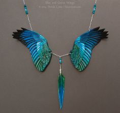 Blue and Green Wings - Leather Necklace by windfalcon Artisan Crafts / Leatherwork / Accessories©2014-2015 windfalcon A pair of blue and green wings, carved from 7 and 3 oz leather and painted with acrylics. https://www.etsy.com/listing/126556062/custom-leather-wings-necklace-bird-wing