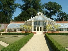 A large greenhouse with a feature double height hexagonal central section!