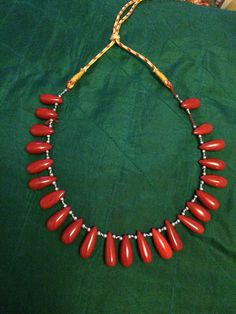 Red Bead necklace My mother in law gives me some nice funky pieces and I love them. It's beautiful, quirky and unique. Sge does give ne the most rare pieces for my collection. #jewelery #necklace # quirky #red