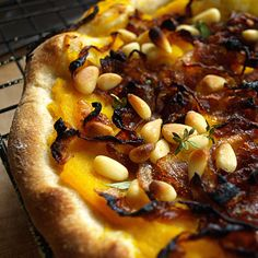 Pumpkin, caramelized onion and pine nut pizza - these flavours are making my mouth water...