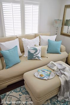Layer aqua and white with neutrals for a casual coastal look. Use white Euro pillows, stacked with standard toss pillows. Floor lamp with blown glass accents, perfecting for reading. A Nicole Miller throw for cool Spring, not quiet Summer evenings, all at a HomeGoods price! #homegoodshappy sponsored pin.