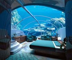 Stay in the underwater hotel. Jules' Undersea Lodge in Key Largo, Florida. This is one of the weirdest theme hotels in America. Guests need scuba training—offered on site—to check into this hotel's underwater suites. Hotel Subaquático, Hotel Dubai, Dubai Uae, Dubai City, Hotel Suites, Beautiful Hotels, Beautiful Places, Amazing Places, Amazing Hotels