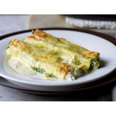 Crab and rocket cannelloni recipe - By Australian Table, Cannelloni is a classic Italian pasta dish, but this recipe features crab and rocket as the filling, taking an everyday dinner to a whole other level.