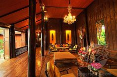 The intriguing and mesmerising interior at Jim Thompson House, Bangkok. Gaze at the rooms filled with collections of Jim Thompson's antiques, including Chinese blue and white Ming pieces, Burmese statues and a dining table which was once used by King Rama V of Thailand.