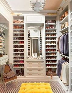 A beautiful walk in closet design that serves as a dressing room!