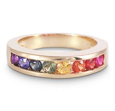 rainbow ring- looks like my wedding band, but alive with colored gemstones, not diamonds...