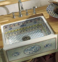 country kitchen sink!!! awwwwesome!! notice the design going around the bottom of the sink, roosters!!!!!! never seen a sink like this!!!! sooo country!!!!!
