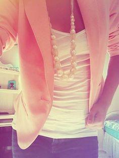 peach blazer, white tank, and pearls