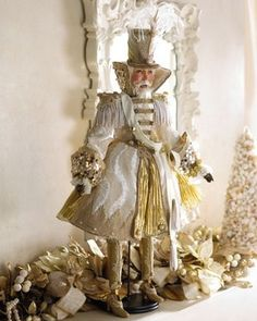 Katherine's Collection Nutcracker Large Doll stunning Nutcracker large doll dressed in the most lavish fabrics and material trims. Resin made and hand painted to detail, dressed in cream and gold with embroidery trims lavish gold buttons and stunning vintage lace and pearls, his beautiful long hat has been beautifully done with cream feathers, His resin gold legs also have vintage lace and also on his shoes, nutcracker is the perfect display this season.