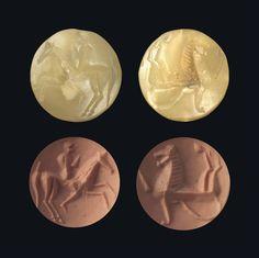 "A GREEK PALE YELLOW STEATITE LENTOID ""ISLAND GEM"" -  CIRCA LATE 7TH CENTURY B.C."
